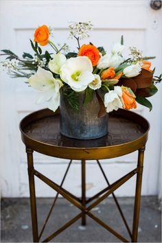 Rustic floral arrangement ideas. #weddingchicks Captured By: Lightbox Photography http://www.weddingchicks.com/2014/06/20/funky-braided-wedding/