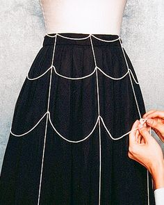 Cheap almost free DIY costume idea: Add any white string or thin ribbon over a black skirt to create a spider web pattern!