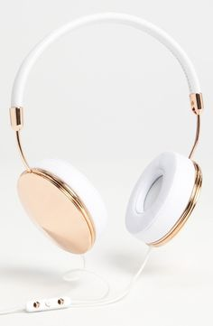 Gold and white headphones.