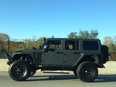 Matte black Rhino-lined Jeep Wrangler Unlimited