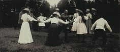 Romanov family members playing a game. Love, love, love this picture. The Czar is in the center and dying laughing. Love Olga's sweet look.