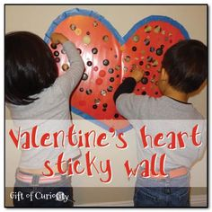 Valentine's heart sticky wall: A fine sensory art project that is perfect for preschoolers || Gift of Curiosity