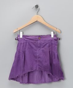 This distinctive skirt will weather every fashion monsoon with laid-back class. A buttoned waist and soft, sumptuous fabric make it a perfect style staple. Frayed hems provide a final touch of elegance.100% cottonMachine wash; tumble dryImported
