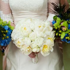 The bridesmaids' bright green and blue bouquets, accented with peacock feathers, provided a brilliant contrast against Anne's all-white bunch of peonies and ranunculus.