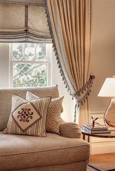 Soft Roman shade & side panel drapes in same fabric; coordinating trims