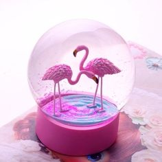 Flamingo Snow Globe ($19) ❤ liked on Polyvore featuring home, home decor, holiday decorations, snow-globe, snow dome, flamingo home decor and snow globes