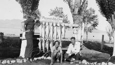 Clark Gable, John Albert Marshall II, and an unidentified woman at Pyramid Lake, NV