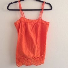 BOGO Roxy orange tank top Adorable design on the bottom. Tag doesn't have a size but I am a medium, fits me well. Would fit a small as well though. My sister tried it on and she's a small. Neon orange/ red color. Will be discounting bundles of two or more items. (: sorry no holds and no trades at this time. Roxy Tops Camisoles