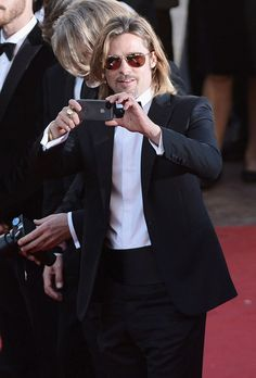 """Sometimes,  even celebrities want to capture the moment. A solo Brad Pitt busted out his iPhone to snap a couple of pics on the red carpet at the  premiere of his upcoming movie """"Killing Them Softly"""" in Cannes on Tuesday.  Wonder if he emailed it to Angelina and the kids."""