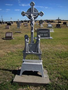 St. Fidelis Cemetery -      Victoria, Kansas. The cemetery features some interesting early German metal cross grave markers.