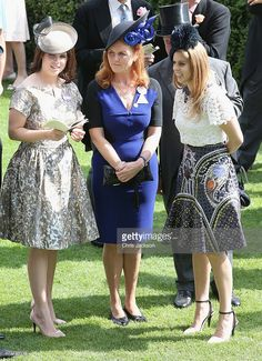 Princess Eugenie, Princess Beatrice and Sarah Ferguson, Duchess of York hold hands in the parade ring on day 4 of Royal Ascot at Ascot Racecourse on June 19, 2015 in Ascot, England.  (Photo by Chris Jackson/Getty Images)
