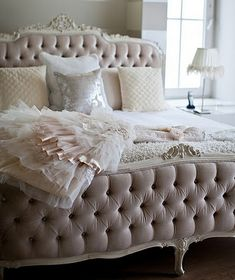 Very glamorous bedroom & bedding!  Ruffles, tufted carved bed, blush colors, chic
