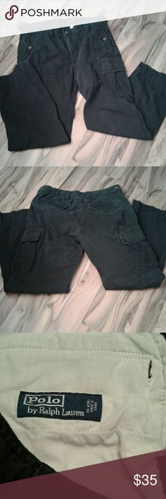 Polo Ralph Lauren men's black cargo pants sz 36/32 These are a pair of pre-loved black cargo pants.  There are generous button front, back and side pockets. There are no rips or stains, but there is some distressed wear at the waist, pocket flaps and hem (see pic 4). Polo Ralph Lauren Pants Cargo