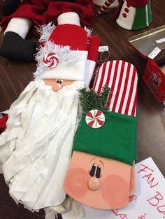 How clever is this....fan blades....Santa's beard is made out of shredded old sheets, and the hats are little sweaters etc she gets at thrif...