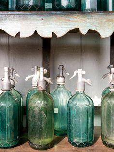 Seltzer bottles can add patina to a bar cart.