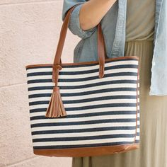 This large and roomy purse can also be used as a tote, as well. We carry this style in 7 trendy colors and patterns. This is the navy and white striped pattern