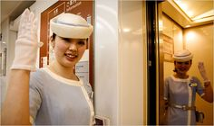 """TOKYO — Every day, the impeccably dressed """"elevator girls"""" of Tokyo's Odakyu department store greet customers, ushering them in and out of the cars. During breaks, they practice their greetings and meticulously reapply their makeup."""