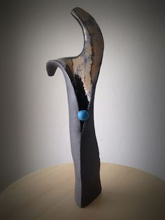 An abstract sculpture in clay  by Anne Beaurin of the Hangar Artists - Abstract Vibrations IV