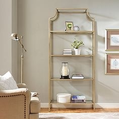 Crosley Aimee Glass Etagere in Gold  With its refreshing update on the standard bookcase, the Crosley Aimee Glass Etagere provides unique visual flair with pagoda styling. The metal and glass construction along with antique gold finish offers subtle elegance without overwhelming a room.