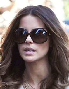 Kate Beckinsale wearing over-sized sunglasses.