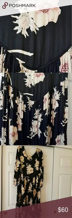 """Rare floral maxi dress by Anna Bella. Beautiful floral pattern. One size but I would recommend Size 10-14. Beautiful heavy rayon blend with a sateen feel.. it wears like a warm hug. 20"""" pit to pit. 55"""" long from shoulders. 3 overlapping rows of 6"""" ruffles at the bottom. Scoop neck. Wrinkle free. Anna Bella Dresses Maxi"""