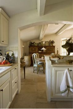 Provencal kitchen -- love the beams and arched doorway