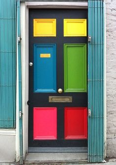 Eeny, meeny, miny, moe. When you just cannot decide which color to use, go with all of them. | color block door, yellow, blue, green, red, pink