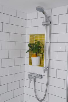 Bianco tumbled instead, subway tiles with grey grout. Yellow onyx brick instead of glass tile