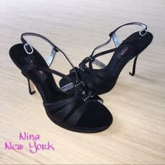 Nina New York Ginnie Slingback Pumps Size 7.5 At your next special occasion, add some sparkling elegance with these gorgeous Nina New York Ginnie Slingback pumps. These strappy black luster satin heels have only been worn once and are in excellent condition. The rhinestone details add the perfect amount of sparkle to these beautiful shoes. The soles are made of composition leather and the heel strap is adjustable. The shoes come with the original box and dustbag. They are a size 7 1/2 and…