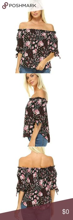 Floral off the shoulder top Black and pink multi floral print , off the shoulder top,  3/4 sleeves with ties on each side. Tops Blouses