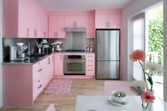 a very pink kitchen :) throw some hello kitty in there and we're all set! @Becca Ruszkowski