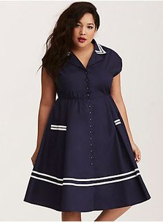 """This navy cotton swing dress goes for all the retro rockabilly feels with a button down front that lends a fitted silhouette. White piping lines the prim foldover collar and along the swing skirt. A stretch waistband has nipped-at-the-waist appeal.<div><br></div><div><b>Model is 5'10"""", size 1<br></b><div><ul><li style=""""list-style-position: inside !important; list-style-type: disc !important"""">Size 1 measures 44"""" from shoulder</li><li style=""""list-style-position: inside !important; ..."""