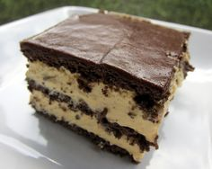 Peanut Butter eclair cake  1 box chocolate graham crackers (there will be a few graham crackers left over)  2 (3 1/4-ounce) boxes vanilla instant pudding  1 cup peanut butter  3 1/2 cups milk  1 (8-ounce) container Cool Whip, thawed  1 can chocolate frosting