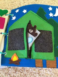 quiet book tent/camping page with finger puppets in sleeping bags, All the stars and the moon have snaps so they can detach and be moved around.