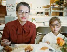 """""""This is me and my mom, circa 1982. I was an extremely picky eater as a kid and each and every meal was a battle. An all-you-can-eat barbecue restaurant was my worst nightmare (probably my mom's, too, from the look on her face). The view of my plate is unfortunately blocked by the flower, but [...]"""