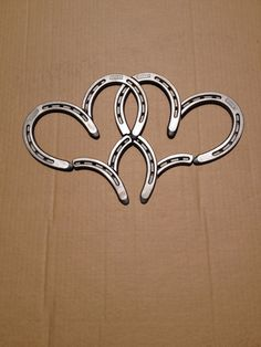 Double Horse Shoe Hearts- This would be cute as a wedding gift with the wedding date on pallet wood.