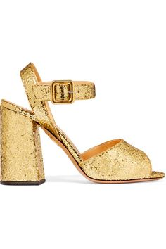 There are few things more party appropriate than a pair of sparkly shoes. Saturated in gold glitter, Charlotte Olympia's 'Emma' sandals are set on an angular block heel that offers just enough height as well as night-long comfort. Wear yours with mini dresses.