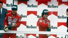 Alain Prost, #11, (finished 1st) ahead of teammate Ayrton Senna, #12, (finished 2nd), McLaren-Honda, Podium  Mexican Grand Prix was held at the Autodromo Hermanos Rodriguez, Mexico City, on May 29, 1988.