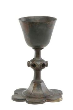 Chalice. Very little medieval church plate survives because it was lost, hidden or converted to other uses during the Reformation. Chalices were supposed to be made from precious metals or pewter, so it is possible that this brass vessel, with hexagonal stem and sexfoil base, was made for burial in a priest's coffin, a custom sometimes observed in the medieval period. The chalice was found in London Wall. Production Date: late Medieval. ID no: A2719
