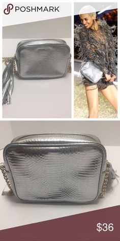 "Victoria's Secret Silver Crossbody Bag Purse Silver faux reptile or snakeskin texture. Silver tassel detail. Gold chain strap and gold zipper. Measures: 8""Lx2.25""Wx6""H VGUC. Pet Friendly + Smoke Free Home. Victoria's Secret Bags Crossbody Bags"