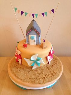 Beach hut cake for 30th birthday. Inside it's blue ombré sponge.