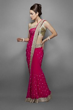 Pink chiffon saree with intricate gold border