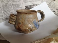 high-fired stoneware mug with Byrd Matte glaze; cream-to-brown with soft blue in spots