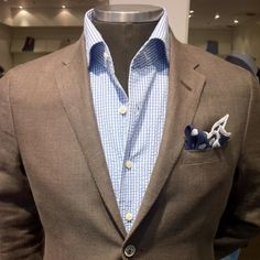 Summer sports coat with blue-toned checked shirt, blue-tone pocket square, dark tan sport jacket. Tan and blue go together exceptionally well.