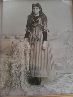 """Labeled a mulatto, her name was Amanda Robinson-Wilkinson. It is rumored that her father, was indeed the slave master. She was allowed to join the """"white family"""" during holidays  special occasions  that """"the masta"""" was especially fond of her because of her beauty! Year unknown."""