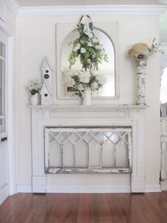 Love the way they used the mantle and the vintage window...