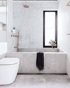 "903 Likes, 9 Comments - S T I L T J E (@stiltje.se) on Instagram: ""Lovely combination of shower and bathtub. The bath built with large tiles. Hexagon Carrara marble…"""