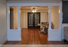 Pony Walls With Columns - I think this would perfectly seperate the livingroom and diningroom without losing the openness of the house. :)