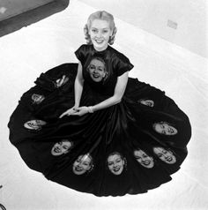 """1940s. Vintage Tech: When Printing Photos on Fabric Was the Next Big Thing. Surrounded by a skirt full of her own pretty face, model Norma Richter shows off dress made especially to demonstrate photographic fabrics."""""""