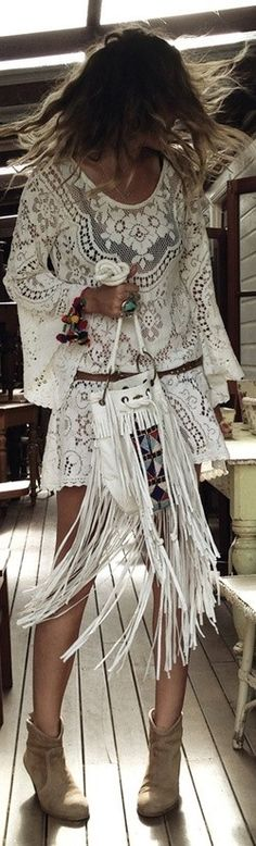 Feeling free in a white boho dress and a fringed bag.